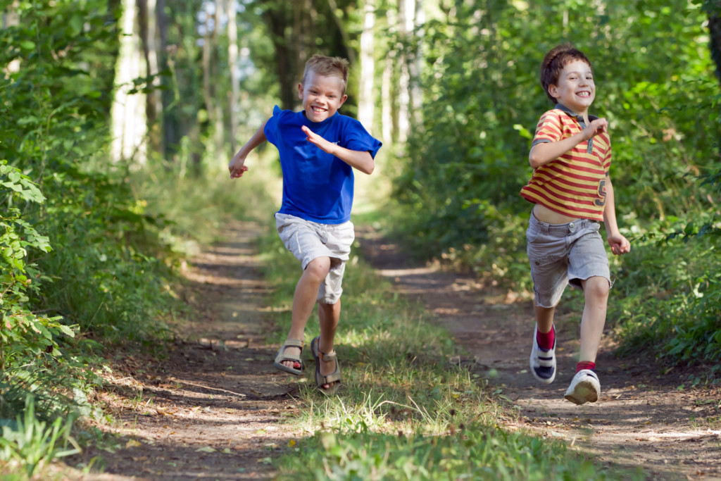Young chidren running in nature