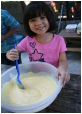 Child stirring a mix in a bowl