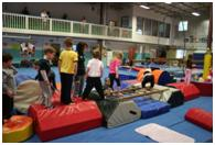 Children playing at gymnastics center