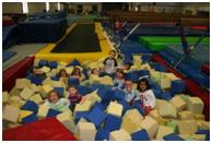Children in a big foam pit